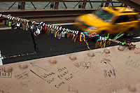 Padlocks as love symbols are seen at the Brooklyn Bridge while it remains under maintenance one day before its 130th anniversary in New York,  May 23, 2013, Photo by Eduardo Munoz Alvarez / VIEWpress.