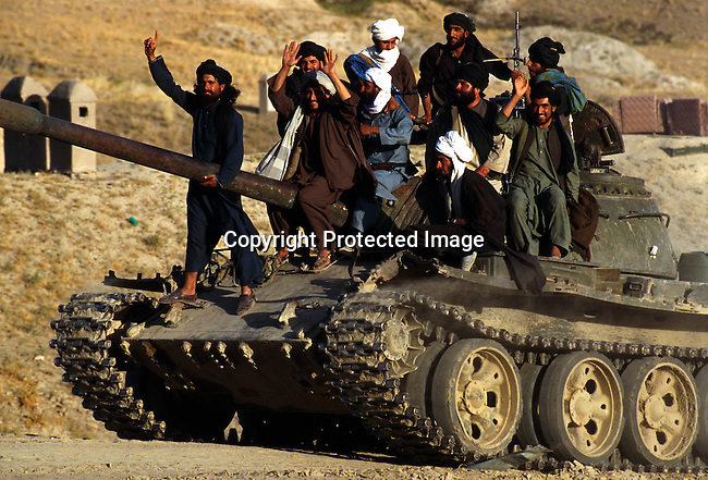 Taliban soldiers outside Kabul, Afghanistan. They took over most of the country in 1996, and have enforced strict muslim law. Women are not allowed to work or go to school..©Per-Anders Pettersson/iAfrika Photos