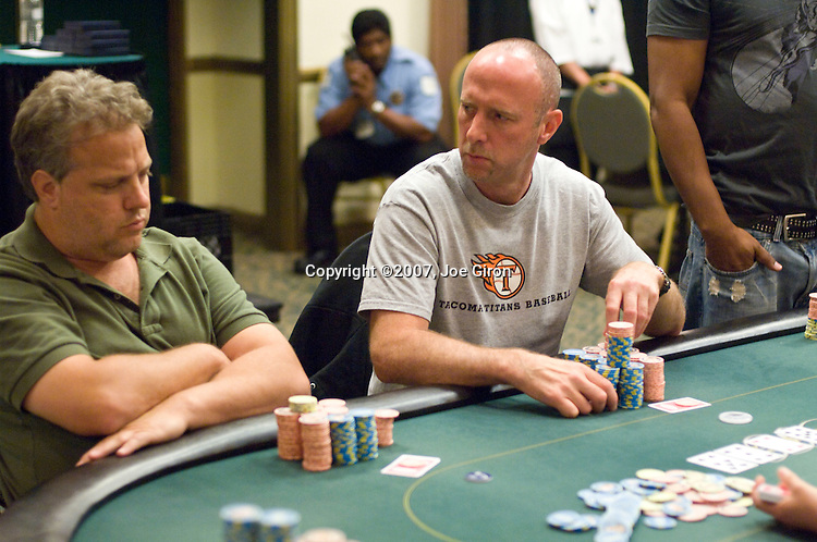 Lee Markholt glances over at Mike McClain during a hand.
