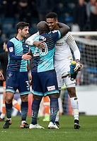 Penalty save hero Goalkeeper Jamal Blackman of Wycombe Wanderers (on loan from Chelsea) gets a hug from Adebayo Akinfenwa of Wycombe Wanderers after the Sky Bet League 2 match between Wycombe Wanderers and Blackpool at Adams Park, High Wycombe, England on the 11th March 2017. Photo by Liam McAvoy.