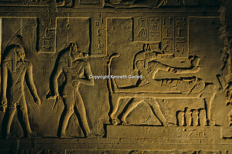 Detail of relief depicts Anubis performing ceremony on pharaoh,relief found in Ptolemaic temple of Amun at Hibis the Darb el-Arbaein, trade route,Egypt; Archaeologist; Salima Ikram; Kharga Oasis;Ancient Cultures; mm7195; Desert; Oasis, canopic, jackel