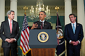 Flanked by United States Secretary of State John Kerry, left, and US Secretary of Defense Ashton Carter, right, US President Barack Obama, center, makes a statement after meeting with his National Security Council at the State Department, February 25, 2016 in Washington, DC. The meeting focused on the situation with ISIS and Syria, along with other regional issues. <br /> Credit: Drew Angerer / Pool via CNP