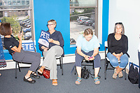 People gather to listen to Chasten Buttigieg, husband of Democratic presidential candidate and South Bend, Ind., mayor Pete Buttigieg, speak at a Buttigieg campaign office opening in Concord, New Hampshire, on Thu., September 5, 2019.