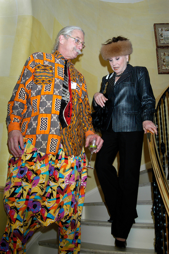 Patch Adams and Cindy Adams at dinner for the Women's Campaign