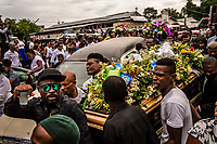 Friends and family carry the coffin of Carlos, 26, who died from a fever, from St Anne's Church on the way to the Grand Cemetery on November 11, 2017 in Port-au-Prince, Haiti. <br /> Photo Daniel Berehulak for The New York Times