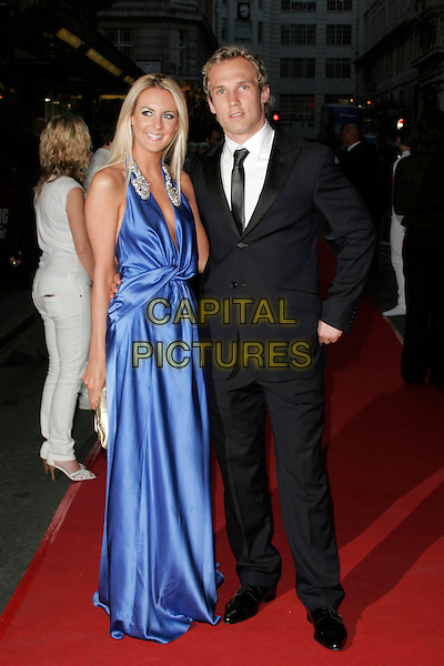 GUESTS (RUGBY PLAYER?).The Never Forget Take That Musical - West End Transfer - gala night, Savoy Theatre, London, England. .May 22nd, 2008.full length black suit blue dress silk satin .CAP/AH.©Adam Houghton/Capital Pictures.