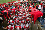 Wisconsin Badgers football team runs out the tunnel after warmups prior to an NCAA Big Ten Conference college football game against the Penn State Nittany Lions on November 26, 2011 in Madison, Wisconsin. The Badgers won 45-7. (Photo by David Stluka)