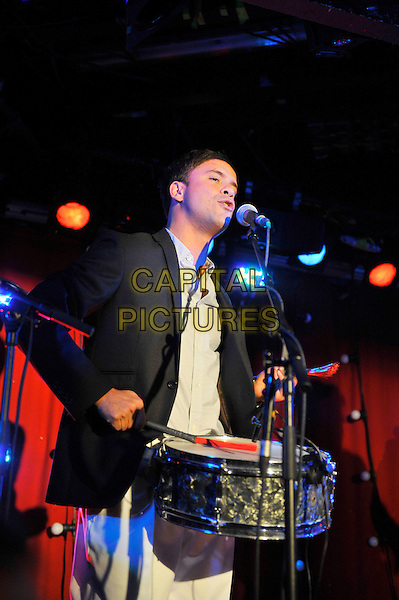 Manuel Polin of Gypsy Queens performing at Madame JoJo, Soho, Lodon, England. .20th September 2012.on stage in concert live gig performance music half length black suit jacket shirt drums singing.CAP/MAR.© Martin Harris/Capital Pictures.