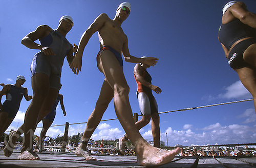 10 NOV 2002 - CANCUN, MEXICO - Richard Stannard (GBR) walks to the start of the 2002 Elite Mens World Triathlon Championship race. (PHOTO (C) NIGEL FARROW)