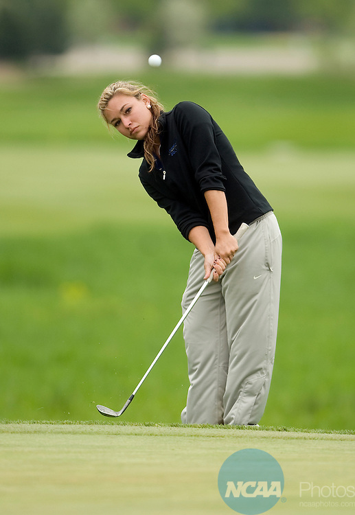 14 MAY 2011: Taylor Collins of Nova Southeastern University chips onto the 18th green during the Division II Women's Golf Championship held at The Meadows in Allendale, MI.  Collins won the individual trophy with a -10 score. Nova Southeastern claimed its third consecutive national championship with a four-round score of 1,157 (+5) on the Meadows Course.  Erik Holladay/NCAA Photos