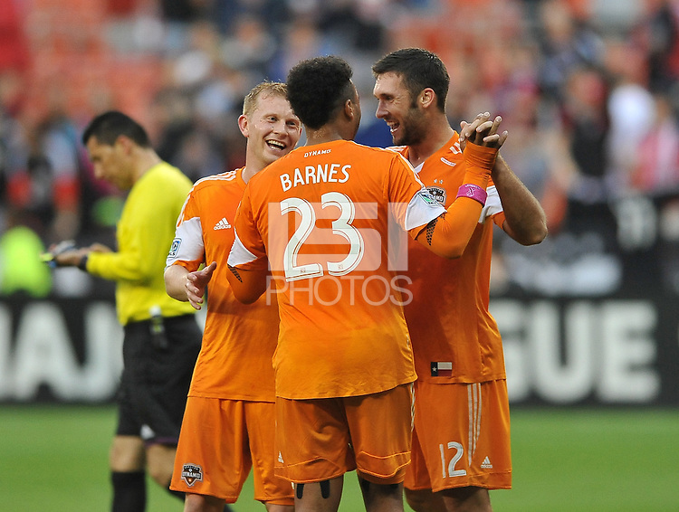 Will Bruin (12) of the Houston Dynamo celebrates with teammates his second goal in the 78th minute of the game. The Houston Dynamo defeated D.C. United 4-0, at RFK Stadium, Wednesday May 8 , 2013.