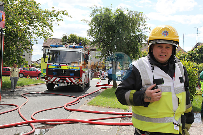 Drogheda fire service responded to a serious house fire in Harmoney Heights on the termonfeckin road on Thursday afternoon. The fire badly damaged the home, the two occupants of the house were taken away sepretly in garda cars..Pic: Fran Caffrey/www.newsfile.ie