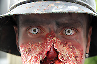 Headshot of Male Zombie wearing a Helmet, close up.