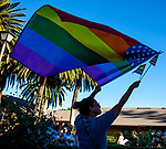 Christy Hayes, of Woodland, waves a large flag during a protest at Dixon City Hall.  A large crowd gathered at Dixon City Hall on Tuesday evening, July 10, 2018 in Dixon, California to protest Vice Mayor Ted Hickman's recent editorial published in the local Independent Voice.   Photos/Victoria sheridan 2018