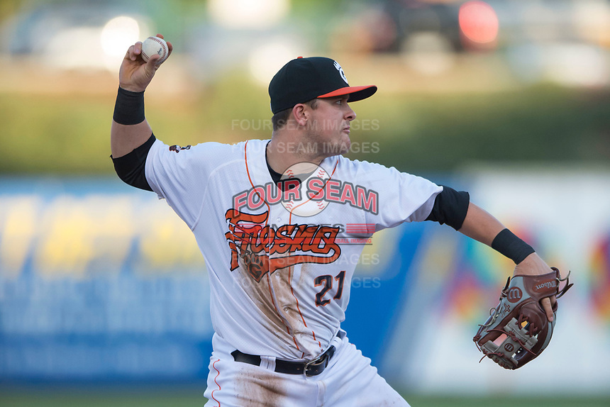 Fresno Grizzlies third baseman JD Davis (21) makes a throw to first base during a Pacific Coast League game against the Salt Lake Bees at Chukchansi Park on May 14, 2018 in Fresno, California. Fresno defeated Salt Lake 4-3. (Zachary Lucy/Four Seam Images)