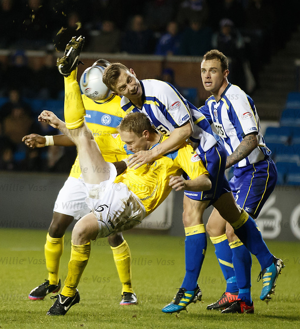 Kilmarnock's Jeroen Tesselaar gets a boot in the face from Steven Anderson as Ryan O'Leary looks on