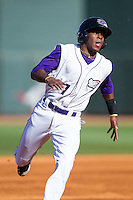 Tim Anderson (7) of the Winston-Salem Dash hustles towards third base against the Salem Red Sox at BB&T Ballpark on April 20, 2014 in Winston-Salem, North Carolina.  The Dash defeated the Red Sox 10-8.  (Brian Westerholt/Four Seam Images)