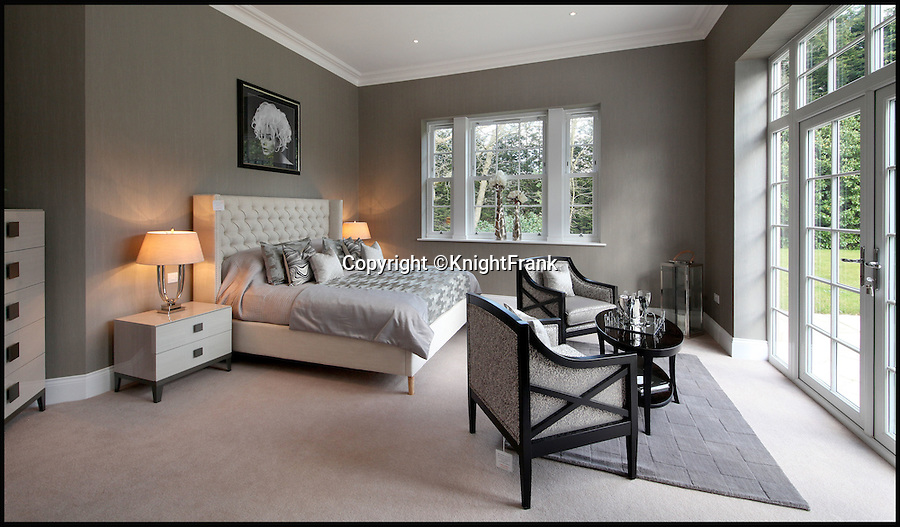 BNPS.co.uk (01202 558833)<br /> Pic: KnightFrank/BNPS<br /> <br /> Bolthole-in-one!<br /> <br /> Main bedroom.<br /> <br /> Golf fans will be green with envy - This brand new Palladian style pad comes with a fantastic view of the 17th green at exclusive Wentworth golf club in Surrey.<br /> <br /> But despite the £6.75 million price tag you will still have to pass muster with the members and stump up a £125,000 joining fee to become part of the world famous club.<br /> <br /> Greenside is part of the Wentworth Estate, one of the most expensive private estates in the country, which has the Wentworth Golf Club at its heart.<br /> <br /> The lucky buyer of this house can watch the world's best golfers battle it out for the European Tour's PGA Championship from the balcony overlooking the 17th green of the iconic West Course.<br /> <br /> The newly-built five-bedroom home, on the market with Knight Frank, has everything you could need, including an indoor swimming pool complex with a sauna and a spa.