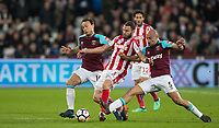 Pablo Zabaleta (5) & Mark Noble of West Ham United battle Erik Pieters of Stoke City during the Premier League match between West Ham United and Stoke City at the Olympic Park, London, England on 16 April 2018. Photo by Andy Rowland.