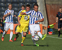 Sammy Clingan being pressured by Adam Drury in the Kilmarnock v St Mirren Scottish Professional Football League Premiership match played at Rugby Park, Kilmarnock on 13.9.14.