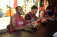 NWA Democrat-Gazette/BEN GOFF @NWABENGOFF<br /> Manuale Watkins (from left), Dustin Thomas and Brachen Hazen of the Arkansas men's basketball team sign autographs for fans on Sunday Oct. 23, 2016 before the Red-White game at Bud Walton Arena in Fayetteiville.