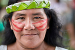 Her face painted red with urucum, a woman participates in a march by indigenous people through the streets of Atalaia do Norte in Brazil's Amazon region on March 27, 2019. They were protesting a central government plan to turn control of health care over to municipalities, in effect destroying a federal program of indigenous health care. Indian rights activists are worried that the government of President Jair Bolsonaro is reducing or eliminating protections for the country's indigenous people.
