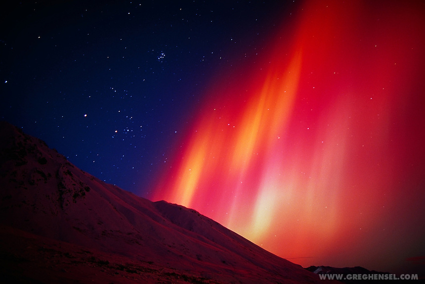 A Red colored Aurora or Northern Lights is an extremely  rare occurrence, even in Alaska. This display was seen over the Talkeetna Mountains in Southcentral Alaska.