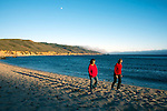 Girlfriends walking the beach at Andrew Molera State Park, Big Sur Valley, California
