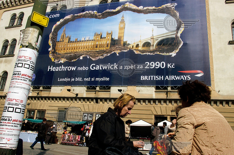 Advertising billboard for British Airways, offering flights to London.