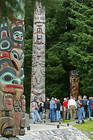 Tourists view totems in the Sitka National Historic Park. Site of a Tlingit Indian Fort and the battle fought between the Russians and the Tlingits in 1804.