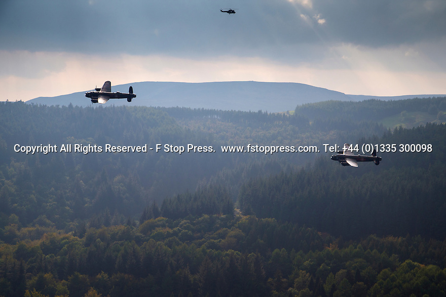 21/09/14 <br /> <br /> Overlooked by an RAF Puma helicopter, the last two airworthy Lancaster bombers in the world  fly over Derwent Dam, in the Derbyshire Peak District, echoing the famous Dambusters raid practised there.<br /> <br /> One of the Lancasters is normally based in Canada, but has been reunited with her Lincolnshire sister for a series of events in the UK.<br /> <br /> The Derwent flypast is partly a tribute to the Canadian men who gave their lives in World War Two.<br /> <br /> <br /> <br /> All Rights Reserved - F Stop Press.  www.fstoppress.com. Tel: +44 (0)1335 300098