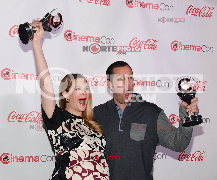 LAS VEGAS, NV - March 27: Female Star of the Year Award winner Drew Barrymore and Male Star of the Year Award winner Adam Sandler at the CinemaCon Big Screen Achievement Awards on March 27, 2014 in Las Vegas, Nevada. © Kabik/ Starlitepics
