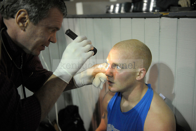 Warren Wenzel of Delta Tau Delta has his eye examined after his fight at the Sigma Chi Fraternity & Alpha Delta Pi Sorority sponsored The Main Event 2011 in Lexington, Ky. Photo by Mike Weaver |