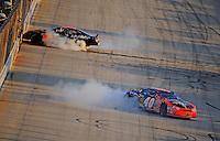 Sept 19, 2008; Dover, DE, USA; NASCAR Camping World Series East driver Matt Kobyluck (40) celebrates clinching the series championship as Aric Almirola (8) celebrates winning the Sunoco 150 at Dover International Speedway. Mandatory Credit: Mark J. Rebilas-