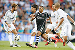 Real Madrid's Sami Khedira against Granada's Youssef El Arabi during La Liga match. September 02, 2012. (ALTERPHOTOS/Alvaro Hernandez).