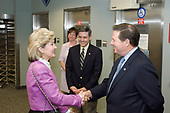 In this photo released by the National Aeronautics and Space Administration, United States Senator Kay Bailey Hutchison (Republican of Texas) and US Representative Tom DeLay (Republican of Texas) shake hands during a visit to the Johnson Space Center in Houston, Texas on 5 August 2005. Robert D. Cabana, JSC Deputy Director, is in background.<br /> Credit: NASA via CNP