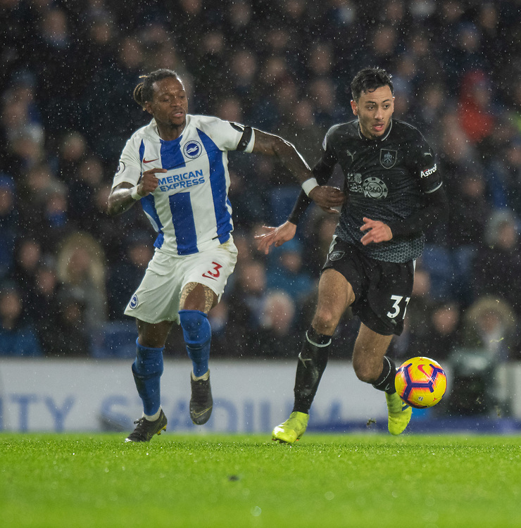Brighton & Hove Albion's Gaetan Bong (left) battles with Burnley's Dwight McNeil (right) <br /> <br /> Photographer David Horton/CameraSport<br /> <br /> The Premier League - Brighton and Hove Albion v Burnley - Saturday 9th February 2019 - The Amex Stadium - Brighton<br /> <br /> World Copyright © 2019 CameraSport. All rights reserved. 43 Linden Ave. Countesthorpe. Leicester. England. LE8 5PG - Tel: +44 (0) 116 277 4147 - admin@camerasport.com - www.camerasport.com