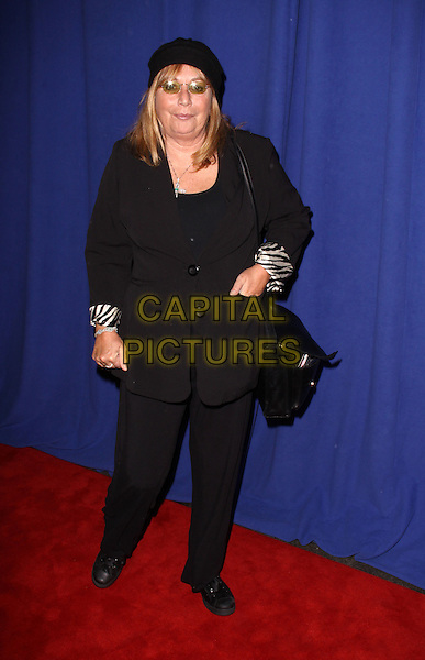 PENNY MARSHALL.7th Annual Joe Torre Safe At Home Foundation's Gala, New York, NY, USA..November 13th, 2009.full length black jacket trousers hat bag purse .CAP/ADM/PZ.©Paul Zimmerman/AdMedia/Capital Pictures.