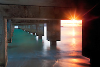 Sunset on underneath part of Hanalei Warf, Kauai, Hawaii.