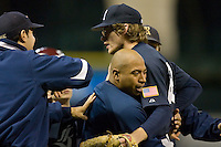 Ryan Berry #28 of the Rice Owls is hugged by teammate Diego Seastrunk #5 following his 2-hit shutout of the Texas A&M Aggies in the 2009 Houston College Classic at Minute Maid Park February 28, 2009 in Houston, TX.  The Owls defeated the Aggies 2-0. (Photo by Brian Westerholt / Four Seam Images)
