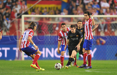 09.05.2014 Madrid, SPAIN . UEFA Champions League Quarter-finals 2nd leg, match played between Atletico de Madrid versus F.C. Barcelona at Vicente Calderon stadium.  Filipe Luis (Atl. Madrid) - Lionel Messi (FC Barcelona) Tiago Cardoso (Atl. Madrid)