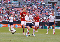 22 MAY 2010:  Germany's Kerstin Garefrekes #18  and USA's Heather O'Reilly #9 during the International Friendly soccer match between Germany WNT vs USA WNT at Cleveland Browns Stadium in Cleveland, Ohio. USA defeated Germany 4-0 on May 22, 2010.
