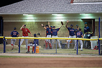 Lowell Spinners bullpen jokingly celebrates after a play during a game against the Batavia Muckdogs on July 16, 2018 at Dwyer Stadium in Batavia, New York.  Lowell defeated Batavia 4-3.  (Mike Janes/Four Seam Images)