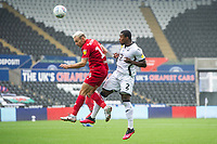 Andreas Weimann of Bristol City under pressure from Marc Guehi of Swansea City during the Sky Bet Championship match between Swansea City and Bristol City at the Liberty Stadium in Swansea, Wales, UK. Saturday 18 July 2020