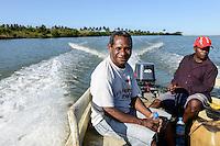 MADAGASCAR , Mananjary, canal des Pangalanes , speed boat trip / MADAGASKAR, canal des Pangalanes, SVD Pater Gabriel Kokon auf Weg zum orf AMBOHITSARA per Boot