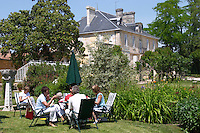 Visiting wine tasters lunching with a picnic pick nick in the garden in front of the chateau in summer Chateau Kirwan, Cantenac Margaux Medoc Bordeaux Gironde Aquitaine France