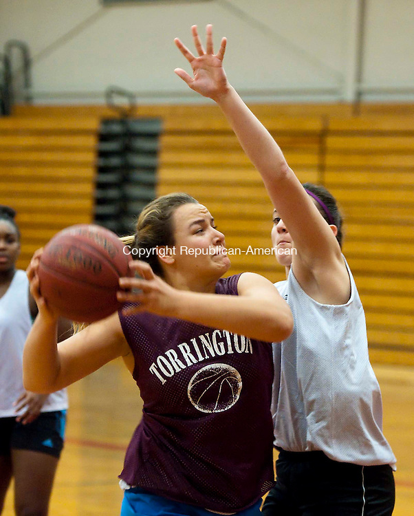 TORRINGTON, CT--- -120215JS08--Torrington's Caitlyn Cornish, left, drives to the basket on Sydney Kovall during pre-season conditions and practice Wednesday at the high school. Jim Shannon Republican-American