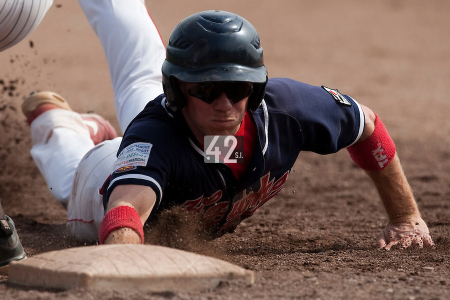 23 May 2009: Waren Guistel of La Guerche slides back to first base during the 2009 challenge de France, a tournament with the best French baseball teams - all eight elite league clubs - to determine a spot in the European Cup next year, at Montpellier, France. Rouen wins 6-2 over La Guerche.
