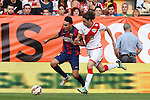 Rayo Vallecano´s  and Barcelona´s Munir (L) during La Liga match between Rayo Vallecano and Barcelona at Vallecas stadium in Madrid, Spain. October 04, 2014. (ALTERPHOTOS/Victor Blanco)