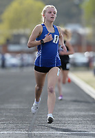 NWA Democrat-Gazette/ANDY SHUPE<br /> Rogers' Anna Jeffcoat comes in at the finish Friday, April 12, 2019, to win the 1,600 meters during the Bulldog Relays at Ramay Junior High School in Fayetteville. Visit nwadg.com/photos to see more photographs from the meet.